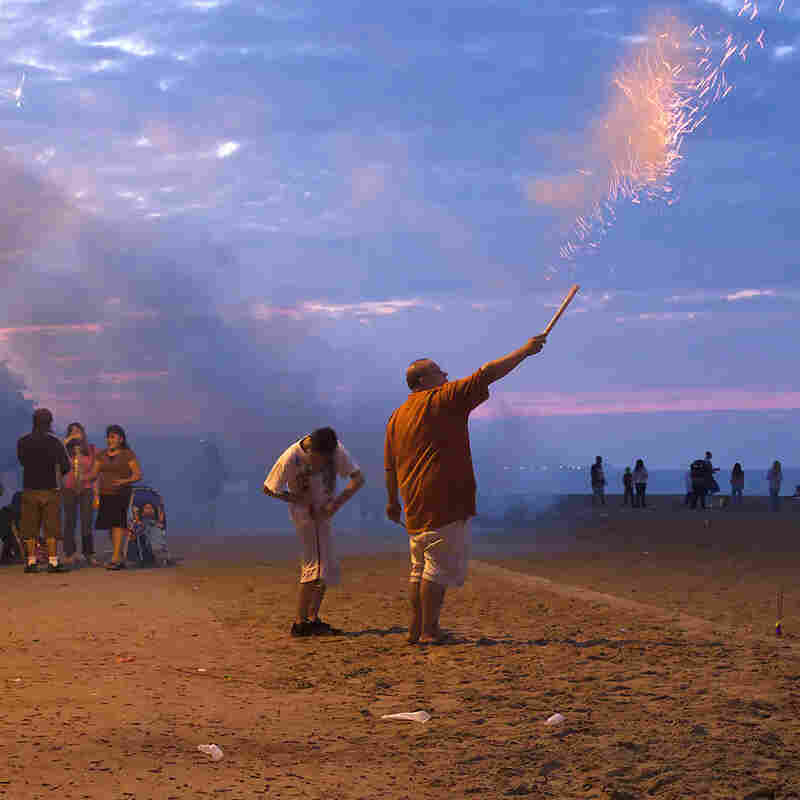 Roman Candle. Chicago. On the night of independence at the beach in my Rogers Park neighborhood in Chicago, the locals come out with their stashes of fireworks purchased in Indiana and Wisconsin and put on their own show on the Lake Michigan shore under the watchful eye of the police.