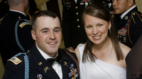Capt. Jared Larpenteur and his wife, Clare, attend a military ball in Fayetteville, N.C., last December.