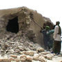 This image from a video shows Islamist militants destroying an ancient shrine in Timbuktu on Sunday.
