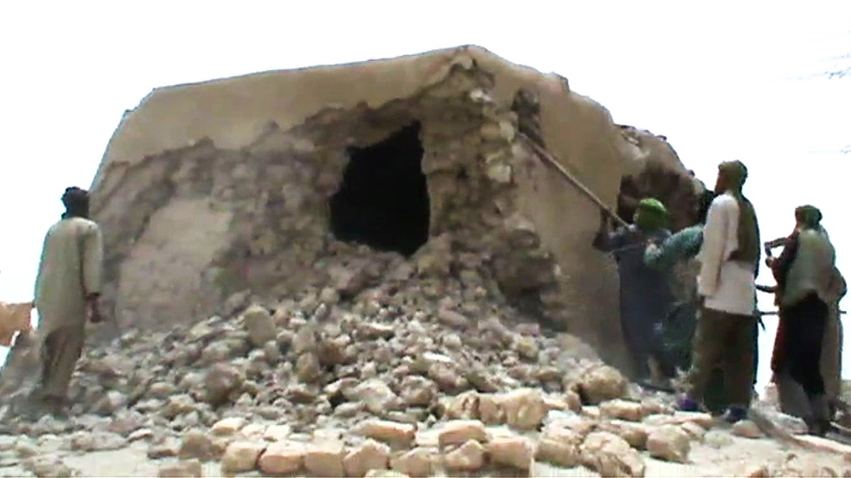 This image from a video shows Islamist militants destroying an ancient shrine in Timbuktu on Sunday. (AFP/Getty Images)