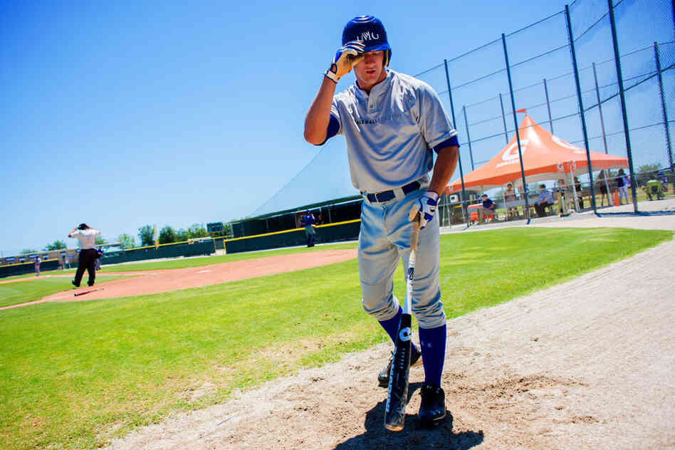 Ketchum Marsh, a high school senior from Massachusetts, walks back to the dugout during a May 21 intrasquad game at IMG Baseball Academy in Bradenton, Fla., where he trains and goes to school.