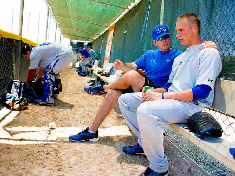 IMG Academy pitching coach Dave Shepard gives pointers to pitcher Cameron Varga.
