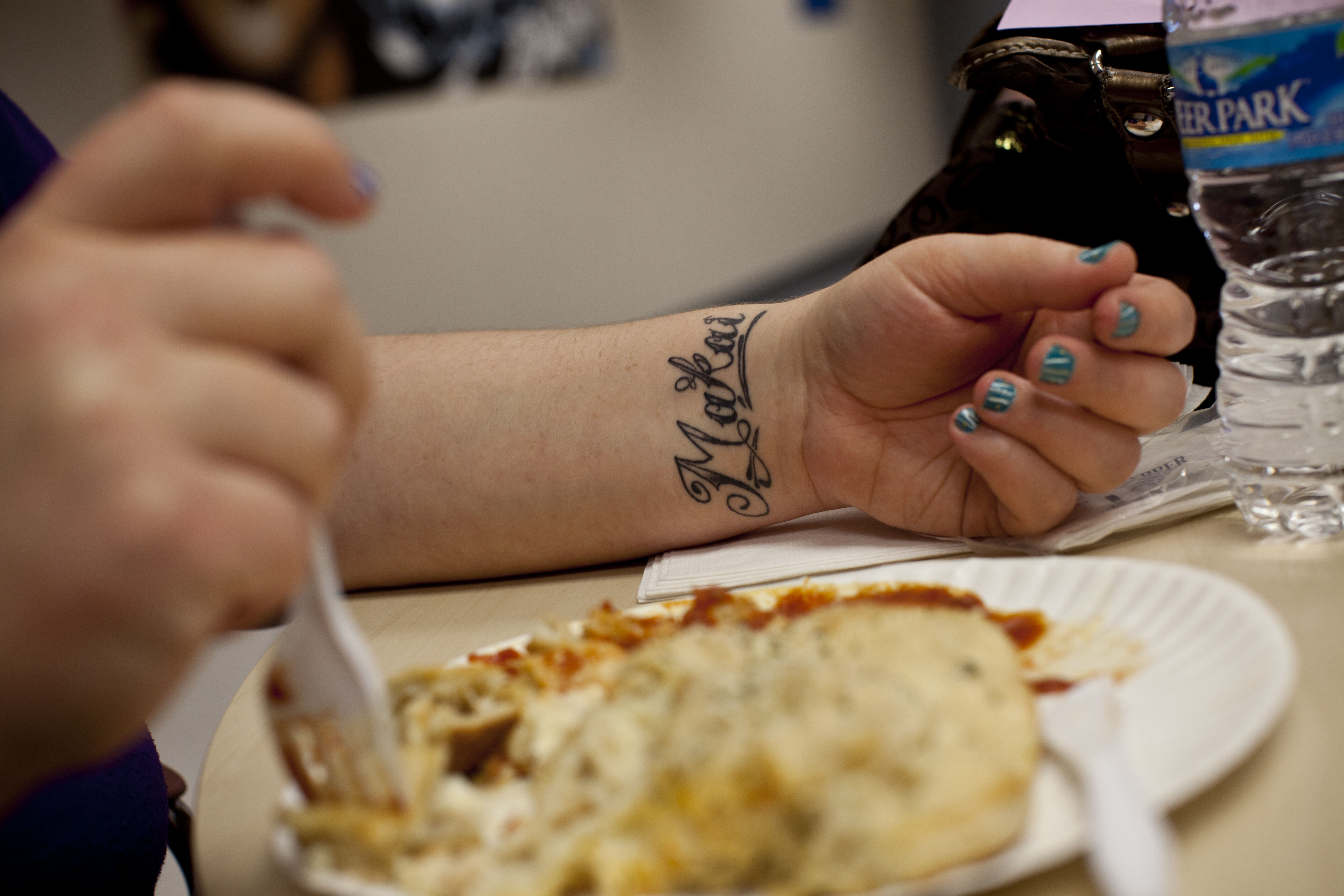 Stepp sports a tattoo of her younger son's name, Makai, on her wrist. I-LEAD, the nonprofit that runs her evening classes, provides dinner for its students.