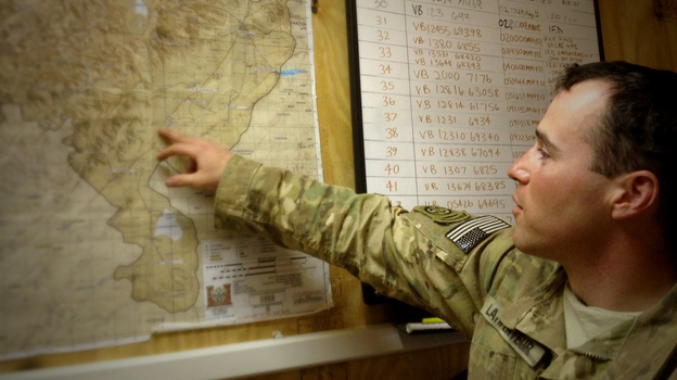 Capt. Jared Larpenteur plans a combat mission at the 82nd Airborne's Delta Company command center in Ghazni province, Afghanistan, earlier this year. (NPR)
