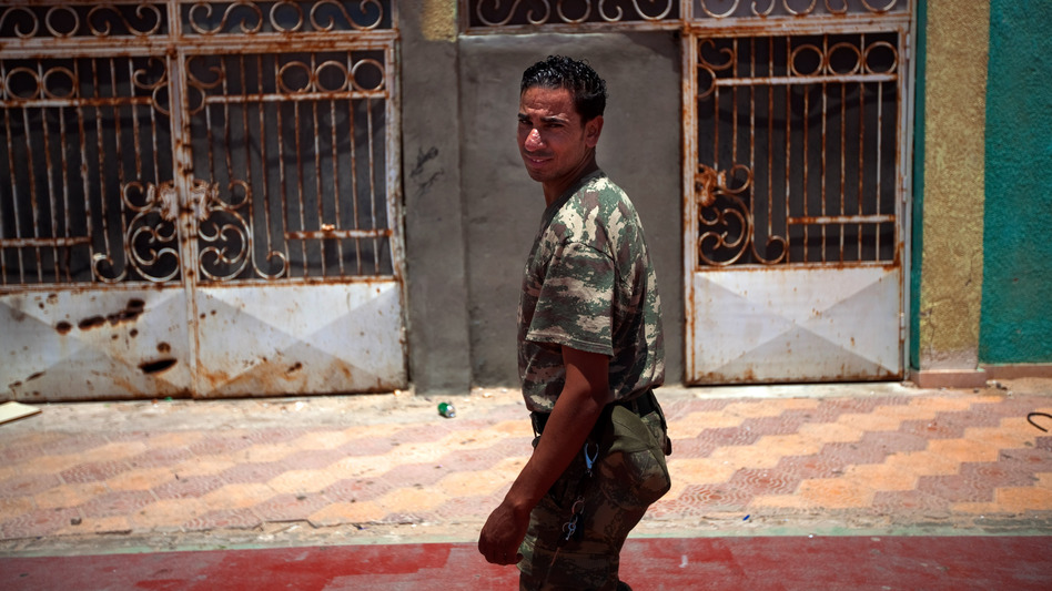 The vice principal at the Okba Bennafee high school, Abdel Mutaleb Suker, is a former rebel who says he started wearing military fatigues to command respect from the students, many of whom come from families loyal to Gadhafi.