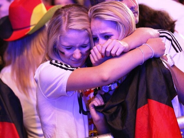 Berlin fans react to Germany's 1-2 loss against Italy at the Fanmeile public viewing at the Brandenburg Gate