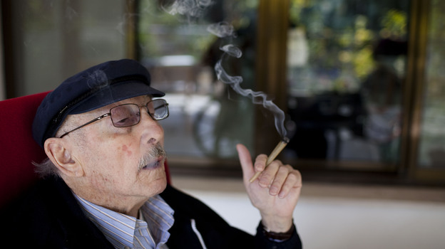Moshe Rute smokes cannabis at the Hadarim nursing home in Kibutz Naan, Israel. In conjunction with Israel's Health Ministry, the Tikkun Olam company is distributing cannabis for medicinal purposes to more than 1,800 people in Israel.