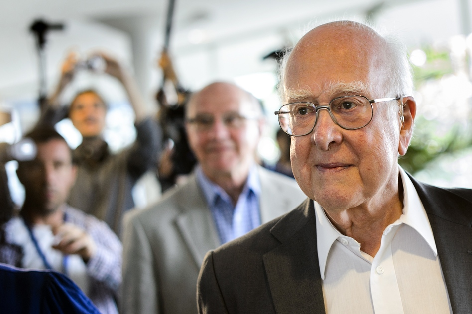 British physicist Peter Higgs, right, arrives for the opening of a seminar to deliver the latest update in the 50-year bid to explain a riddle of fundamental matter in the search for a particle called the Higgs boson. (AFP/Getty Images)