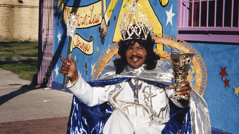 Ernie K-Doe poses outside his Mother-In-Law Lounge during Jazz Fest in New Orleans in 2001. He died a few months later and was buried in St. Louis Cemetery No. 2. (AP)