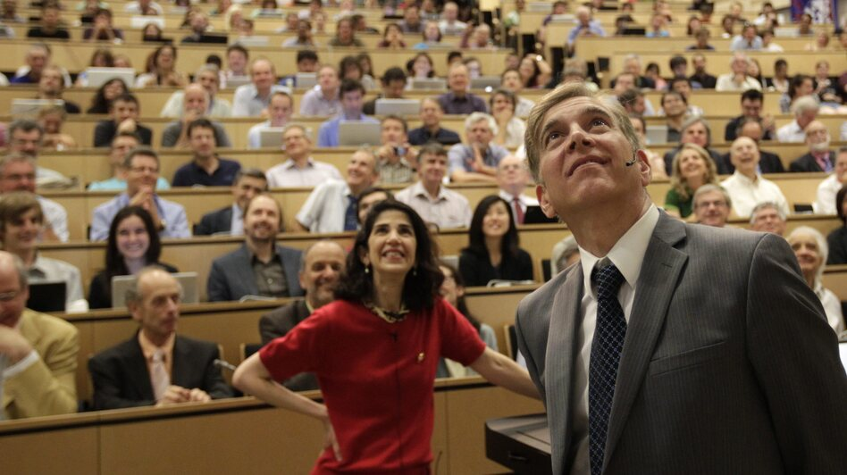 Fabiola Gianotti of the ATLAS group (left) and Joe Incandela of the Compact Muon Spectrometer team announced their findings during a presentation Wednesday in Switzerland. (AP)