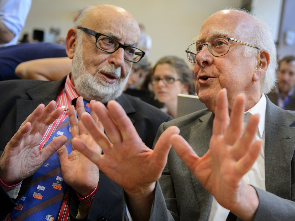 British physicist Peter Higgs (right), who proposed the Higgs bosun in the 1960s, speaks with Belgium physicist Francois Englert during a press conference at CERN offices in Switzerland on Wednesday.