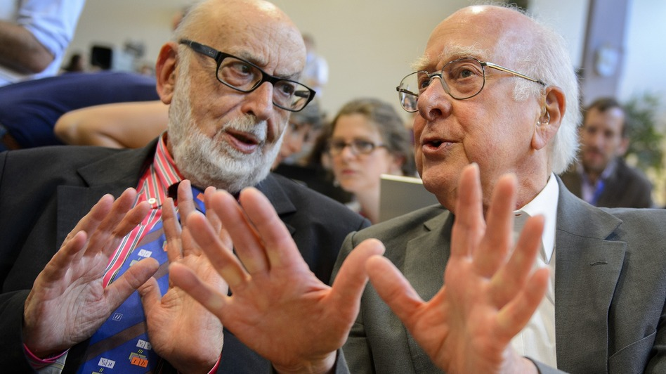 British physicist Peter Higgs (right), who proposed the Higgs boson in the 1960s, speaks with Belgium physicist Francois Englert at Wednesday's event. (AFP/Getty Images)