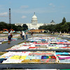 Visitors view the AIDS Memorial Quilt at the National Mall.