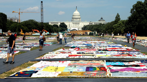 Visitors view the AIDS Memorial Quilt at the National Mall. (NPR)