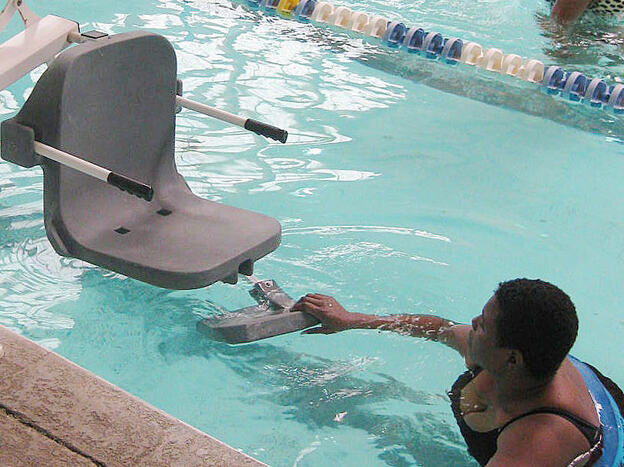 New government regulations require public pools to have chair lifts, like this one in Savannah, Ga., for people with disabilities. The compliance deadline has been extended for a second time.