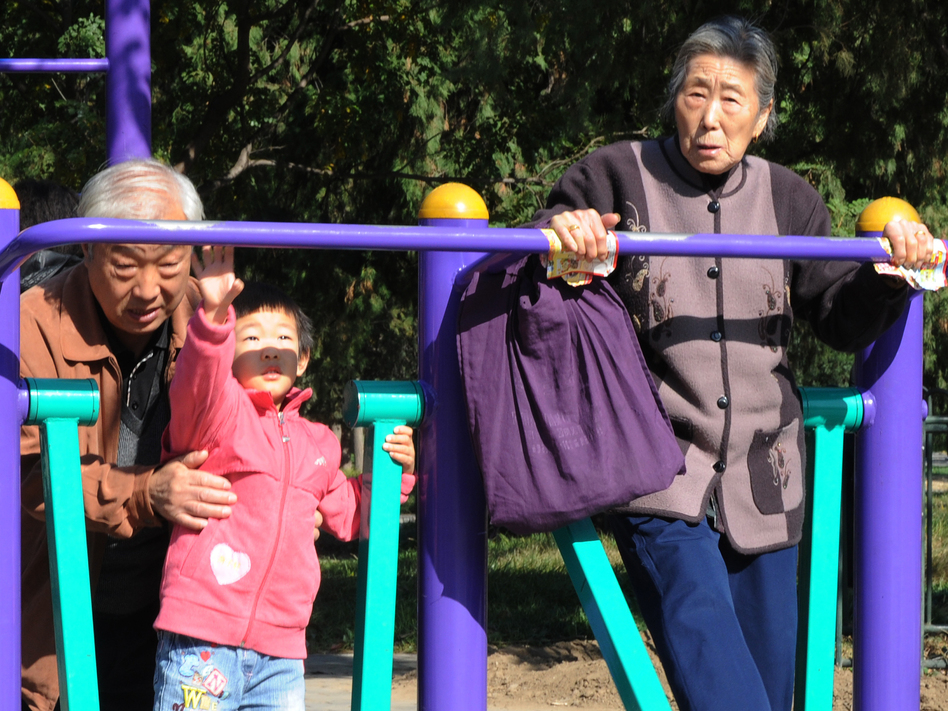 Young and old exercise at the Temple of Heaven park in Beijing in October. Experts say China's health care costs will be difficult to fund due to the population imbalance. (AFP/Getty Images)