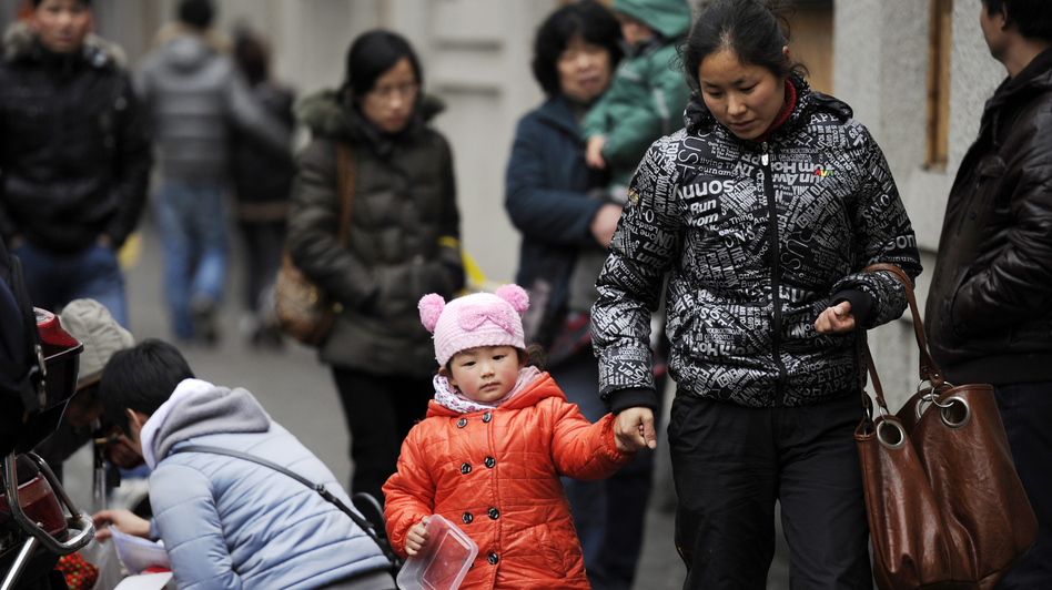 A mother and child walk in Shanghai. China's one-child policy has been in place since 1979. There's now a debate about whether the policy should be eased or dropped. (AFP/Getty Images)