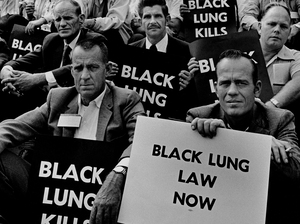 "Coal miners rally for black lung law reform on the steps of the U.S. Capitol in 1975. (See more from Earl Dotter's ""Quiet Sickness"" series here.)"