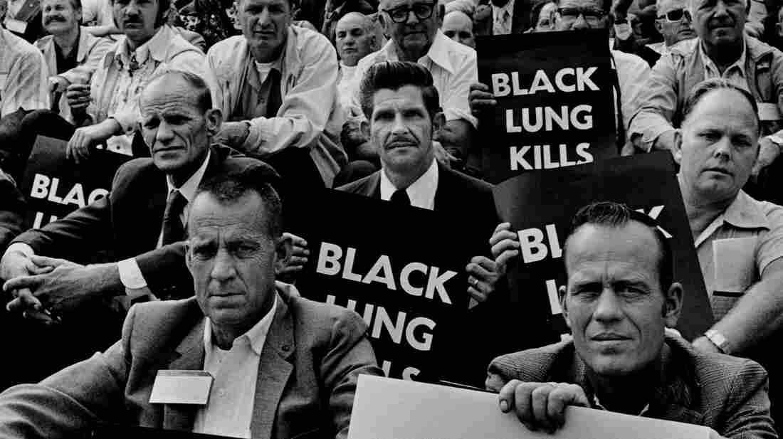 """Coal miners rally for black lung law reform on the steps of the U.S. Capitol in 1975. (See more from Earl Dotter's """"Quiet Sickness"""" series here.)"""