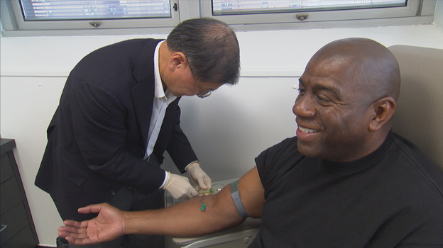 Dr. David Ho, an HIV/AIDS specialist, draws blood from Magic Johnson, one of the people featured in Endgame: AIDS in Black America. (Renata Simone Productions/Frontline)