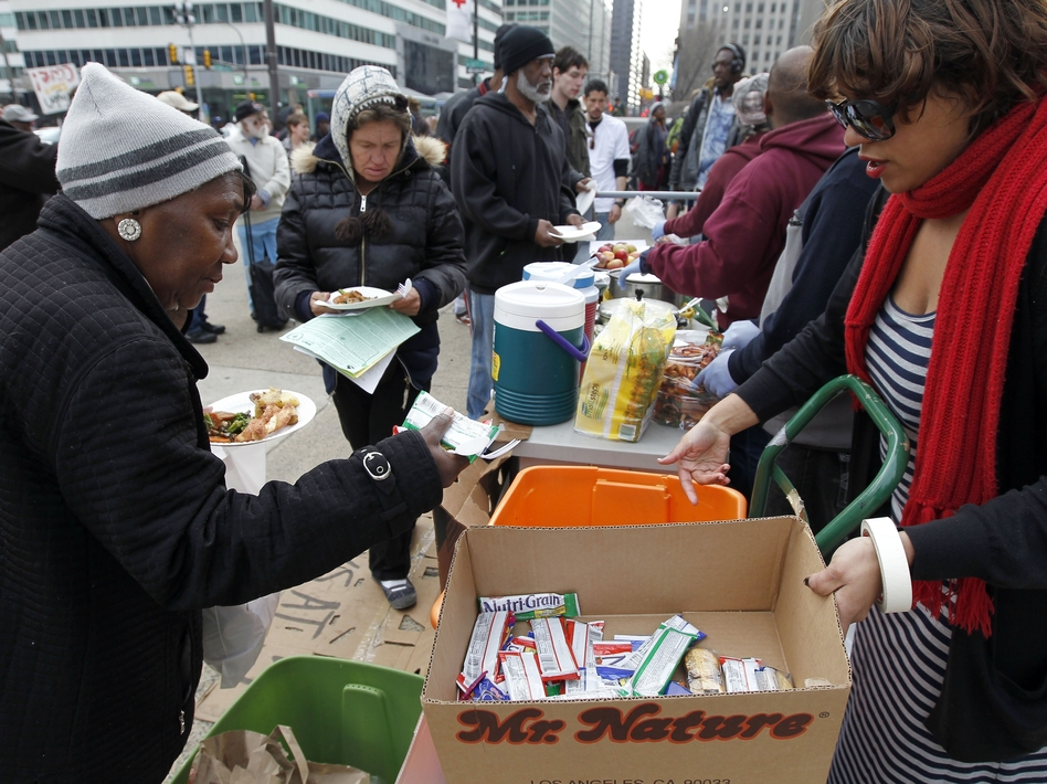 Volunteers distribute food outside a Philadelphia Department of Public Health hearing in March on rules banning outdoor food distribution.