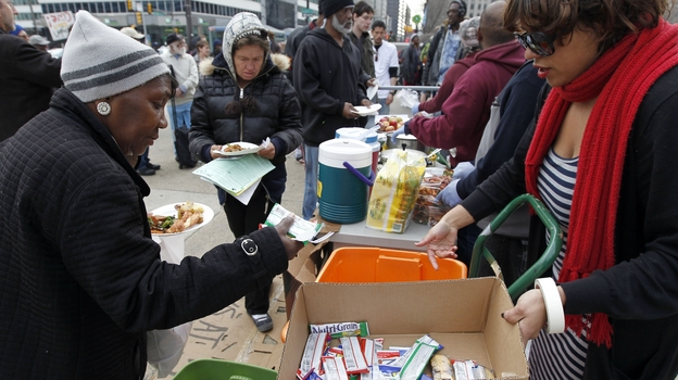 Volunteers distribute food outside a Philadelphia Department of Public Health hearing in March on rules banning outdoor food distribution. (AP)
