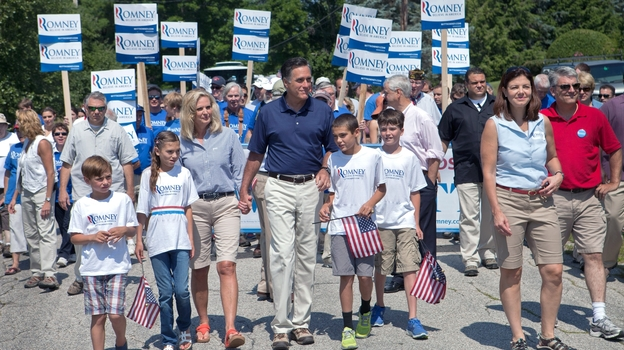 Republican presidential candidate Mitt Romney walks with his wife, Ann, and other family members, along with Republican Sen. Kelly Ayotte, in the Wolfeboro, N.H., Independence Day parade Wednesday. Ayotte has been mentioned as a possible vice presidential contender. (Getty Images)