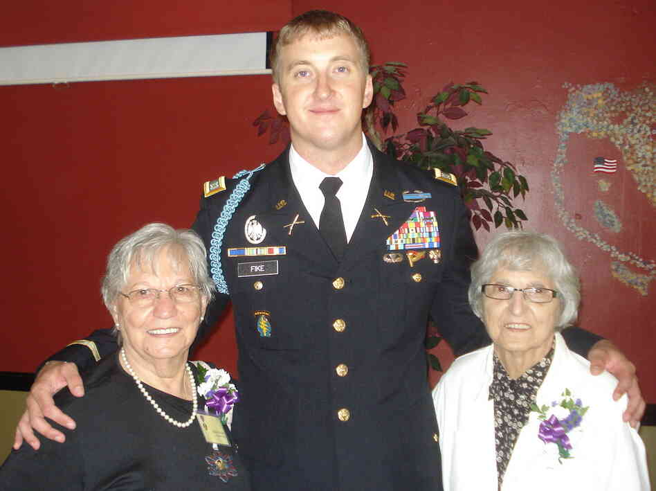 Capt. Zachariah Fike helped reunite sisters Adeline Rockko (left) and Mary Piccoli with the Purple Heart medal of their late brother, Army Pvt. Corrado Piccoli.