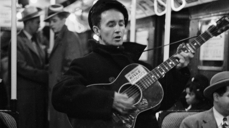 Woody Guthrie singing aboard a New York City subway train. (Life Pictures/Getty Images)