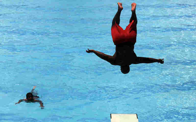 Alex McCall jumps into a pool in the nation's capital on Monday.