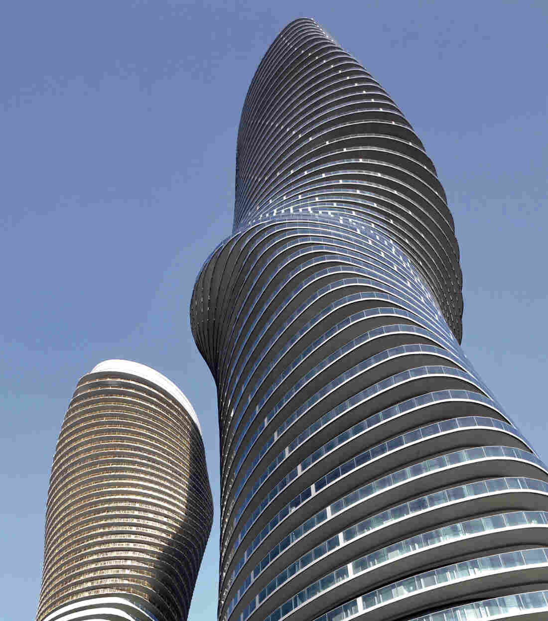 Buildings that wheeze squeeze and dance krulwich for Absolute towers