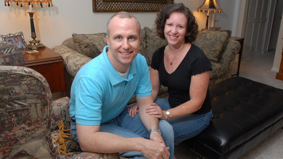 Alan Chambers, president of Exodus International, sits with his wife, Leslie, in their home in Winter Park, Fla., in 2006. Chambers recently announced his group will no longer associate with or promote therapy that focuses on changing sexual attraction.