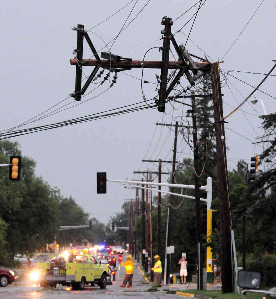 A power pole is bent after severe storms hit the Bemidji, Minn., area on Tuesday, knocking down thousands of trees and causing extensive damage to utility lines. Thousands of customers were left without power.