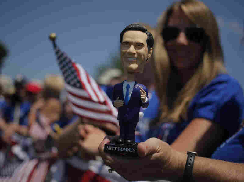 A bobblehead doll of Republican presidential candidate Mitt Romney at the July 4 parade in Wolfeboro, N.H.