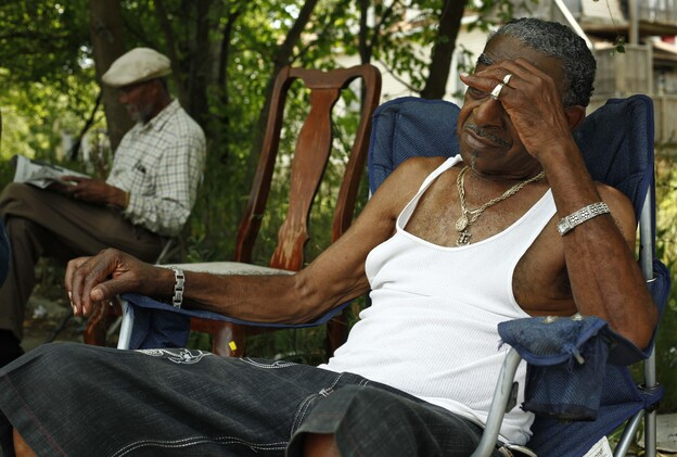 """""""Papa B"""" (left) and """"Cadillac Bob"""" find refuge from the heat in a shaded lot between their homes on Chicago's South Side. (AP)"""