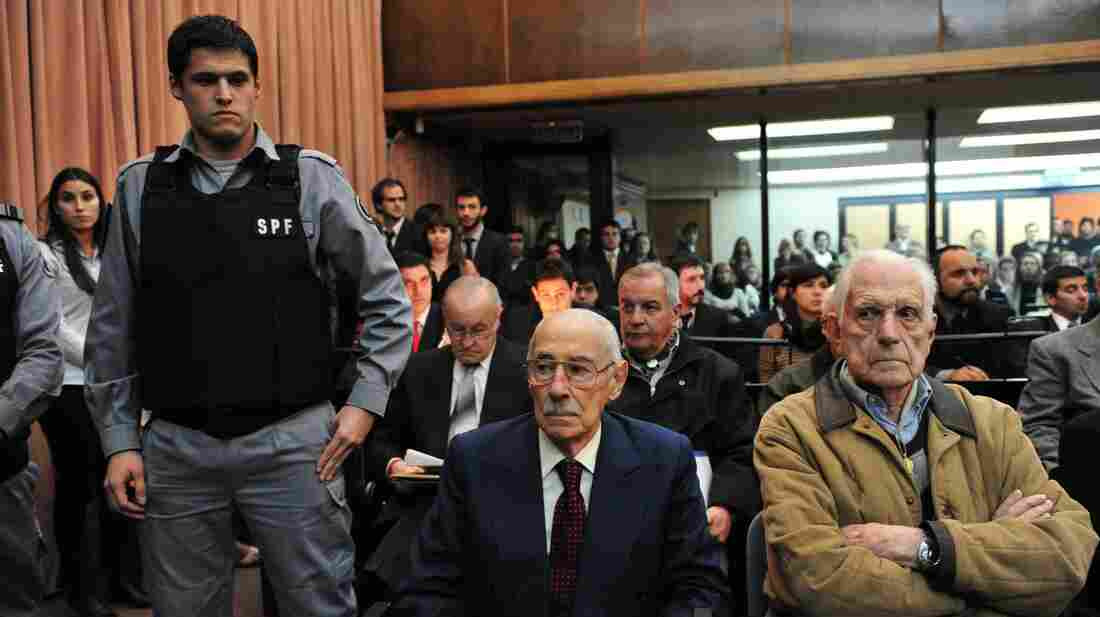 Former Argentinean dictators Jorge Rafael Videla, center, and Reynaldo Bignone, right, were convicted for their roles in stealing babies from political prisoners during the country's military dictatorship in the 1970s and 1980s.
