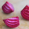 The red and white striations of the Chioggia, or candy cane, beet.