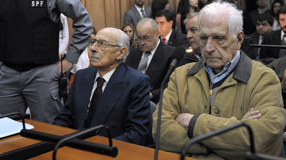 Former dictator and Gen. Jorge Rafael Videla (left), and former general and member of the military junta Reynaldo Bignone in a Buenos Aires court on Thursday. (AFP/Getty Images)
