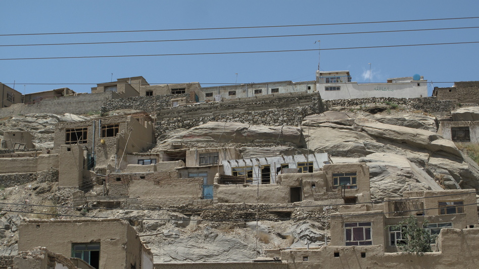 Poorly constructed houses cling precariously to hillsides in Kabul. Such neighborhoods often lack electricity and running water. (Sean Carberry)