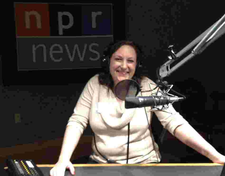 Winner Paula Henning enjoys a tour of NPR's headquarters with host/correspondent David Greene.