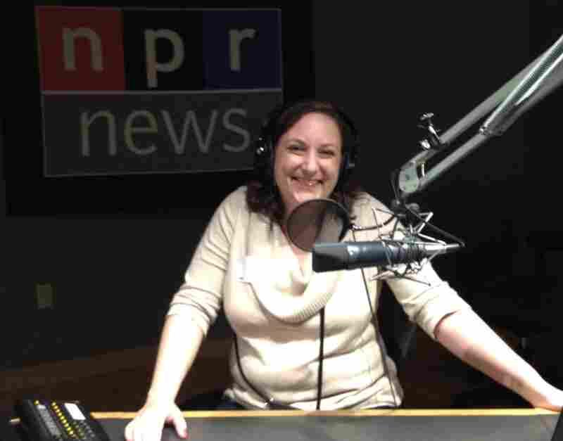 Winner Paula Henning enjoys a tour of NPR's headquarters with host/correspondent David Greene.