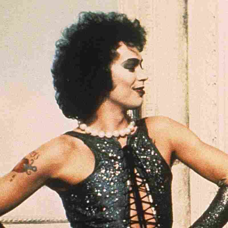 Tim Curry in The Rocky Horror Picture Show with Barry Bostwick and Susan Sarandon in 1975.