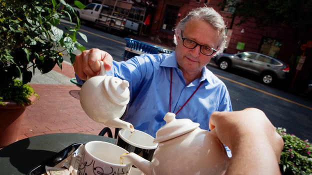 Joe Palca serves up some hot tea on a very hot day at Teaism in Washington, D.C., last week. (NPR)