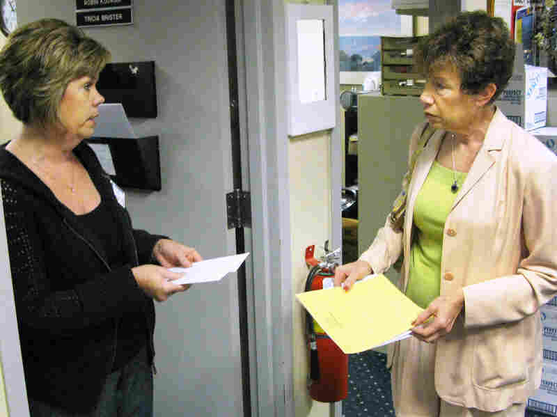 Deborah Klein (right) meets with Tricia Brister, volunteer coordinator at Griffin Hospital in Derby, Conn., about volunteer opportunities.