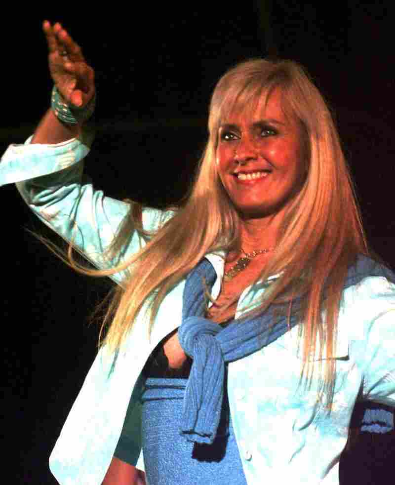 """Helo Pinheiro, who inspired the song """"The Girl From Ipanema,"""" dances during a fashion show in Rio de Janeiro in 1999."""