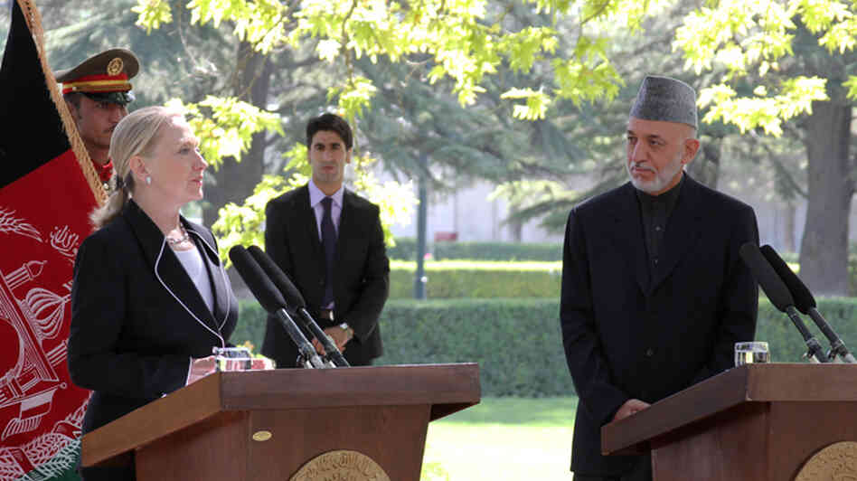 "In Kabul, Secretary of State Hillary Clinton announces that Afghanistan is now a ""major non-NATO ally"" alongside Afghan President Hamid Karzai."