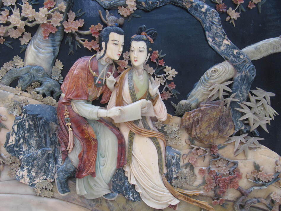The romance between star-crossed lovers Jia Baoyu (left) and Lin Daiyu, depicted here in a relief panel, meets a tragic end in the classic Chinese novel <em>Dream of the Red Chamber</em>.