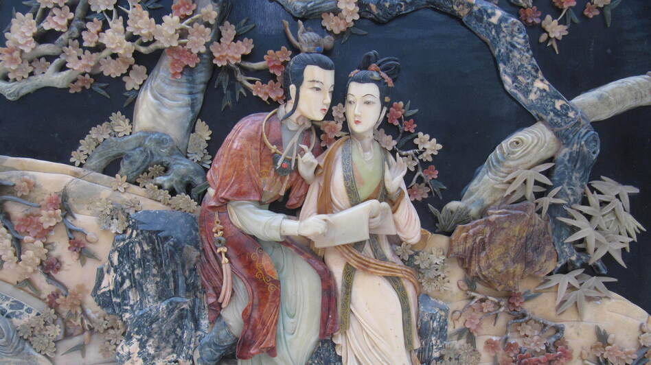 The romance between star-crossed lovers Jia Baoyu (left) and Lin Daiyu, depicted here in a relief panel, meets a tragic end in the classic Chinese novel Dream of the Red Chamber. (Flickr)