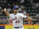 New York Mets pitcher R.A. Dickey delivers his signature pitch, with its unusual grip, against the Arizona Diamondbacks on May 6. He's the only knuckleballer in the major leagues, and the pitch has earned him a 12-1 record so far this season.