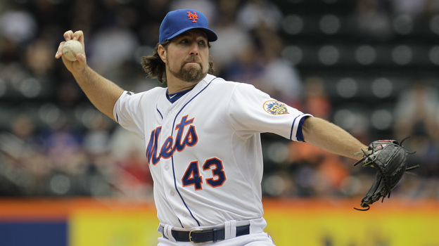New York Mets pitcher R.A. Dickey delivers his signature pitch, with its unusual grip, against the Arizona Diamondbacks on May 6. He's the only knuckleballer in the major leagues, and the pitch has earned him a 12-1 record so far this season. (AP)